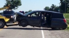 A minivan is towed from the scene after a fatal crash near Clinton, Ont. on Wednesday, June 24, 2015. (Scott Miller / CTV London)