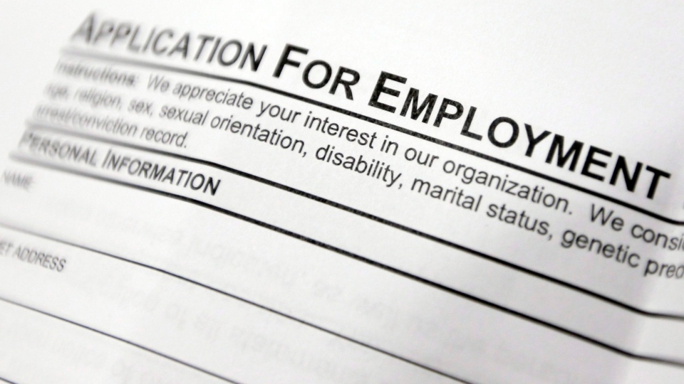 This April 22, 2014, file photo shows an employment application form on a table during a job fair at Columbia-Greene Community College in Hudson, N.Y. (AP Photo/Mike Groll, File)