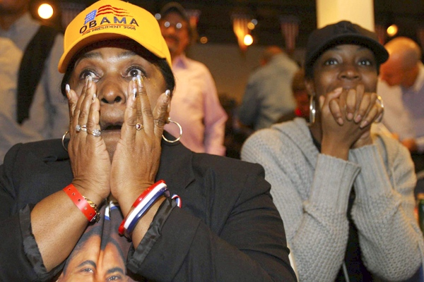 Patricia Saddle, left, wipes her tears after the announcement of Barack Obama's victory in Chicago, Ill., on Tuesday, Nov. 4, 2008. (AP / Eric Y. Exit).