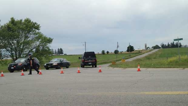 OPP have blocked a section of Westminster Drive for a suspicious death investigation in Middlesex County, Ont. on Thursday, June 25, 2015. (Reta Ismail / CTV London)