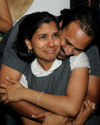 Sandhya Jain-Patel gets a hug from her her husband, Samir Patel, as they watch the announcement that Sen. Barack Obama has won the presidential election in Brooklyn, N.Y., on Tuesday, Nov. 4, 2008. (AP / Brian McDermott)
