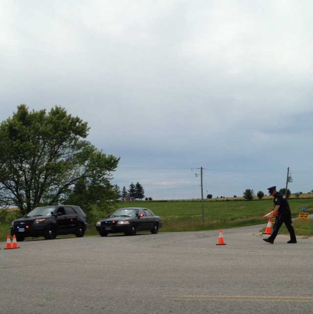 OPP block Westminster Drive at Westchester Bourne as they investigate a suspicious death in Middlesex County, Ont. on Thursday, June 25, 2015. (Reta Ismail / CTV London)