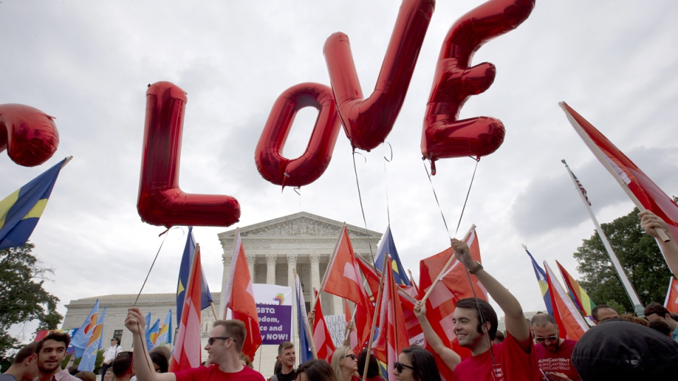 Balloons spell out the word 'love' over the Supreme Court in Washington, Friday June 26, 2015. (AP / Jacquelyn Martin)