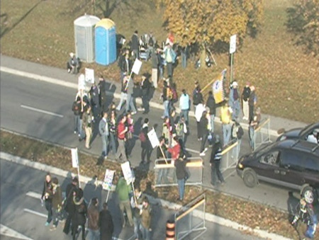 An aerial view shows union members picketing at an entrance to York University in Toronto, Thursday, Nov. 6, 2008.