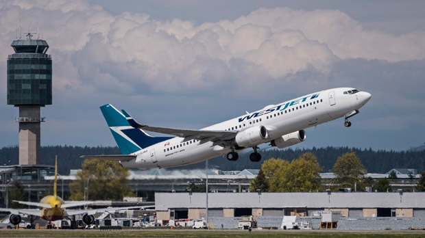 A Westjet Airlines Boeing 737-800 jetliner takes off from Vancouver International Airport, Richmond, B.C., May 4, 2015. (The Canadian Press/Bayne Stanley)