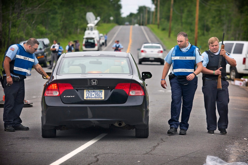 New York State corrections officers check vehicles along State Route 30 at the intersection with Travers Rd. in the town of Malone, N.Y. on Saturday, June 27, 2015 as the search for escaped prisoner David Sweat continues. (Jason Hunter/Watertown Daily Times)
