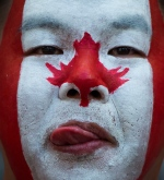 A fan waits for Canada and England to play a FIFA Women's World Cup quarter-final soccer game in Vancouver, B.C., on Saturday, June 27, 2015. (Darryl Dyck / THE CANADIAN PRESS)