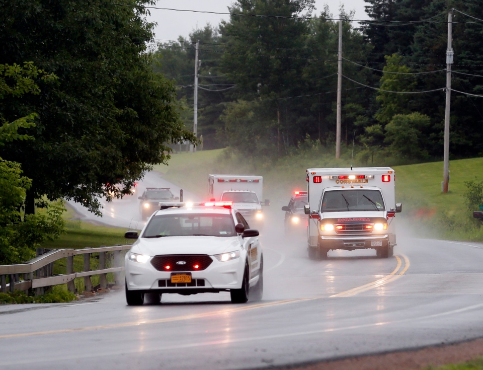 Police escort ambulances from an area where law enforcement officers were searching for convicted murderer David Sweat, one of two convicted murderers who broke out of a maximum-security prison near the Canadian border on Sunday, June 28, 2015, in Constable, N.Y. (AP / Mike Groll)