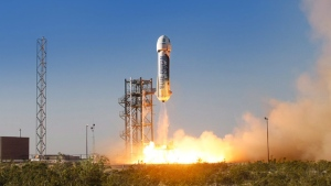 In this Thursday, April 29, 2015 photo provided by Blue Origin, the New Shepard space vehicle blasts off on its first developmental test flight over Blue Origin's west Texas Launch Site. (Blue Origin / AP)