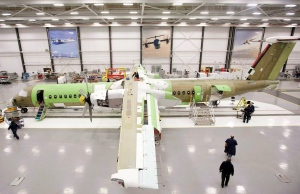 Bombardier Aerospace employees assemble a Q400 airliner at the Bombardier aircraft manufacturing facility in Toronto, March 25, 2011. (Darren Calabrese / The Canadian Press)