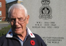 Al Hebburn, 92, of Toronto, survived the Battle of Dieppe and the invasion of Normandy as an infantryman, stands by a memorial outside Branch 31 of the Royal Canadian Legion Tuesday, Nov. 4, 2008. (THE CANADIAN PRESS / Colin Perkel)