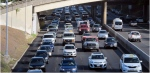 In this Friday, June 26, 2015 photo, drivers head into downtown Honolulu from the island's West side. (AP Photo/Cathy Bussewitz)