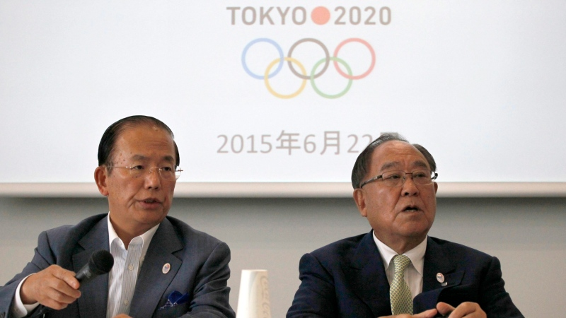 Tokyo 2020 Olympics CEO Toshiro Muto, left, and Honorary President Fujio Mitarai speak during a news conference in Tokyo, Monday, June 22, 2015. (AP / Ken Moritsugu)