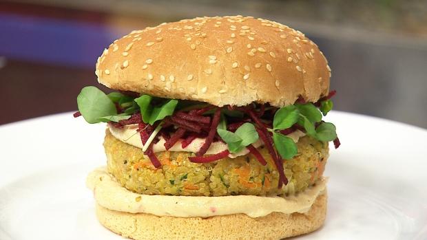 Quinoa veggie burger with watermelon, tomato and feta salad