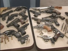 On Thursday, Nov. 6, 2008, Toronto police display some of the firearms turned in so far during the 'Pixels for Pistols' amnesty program.