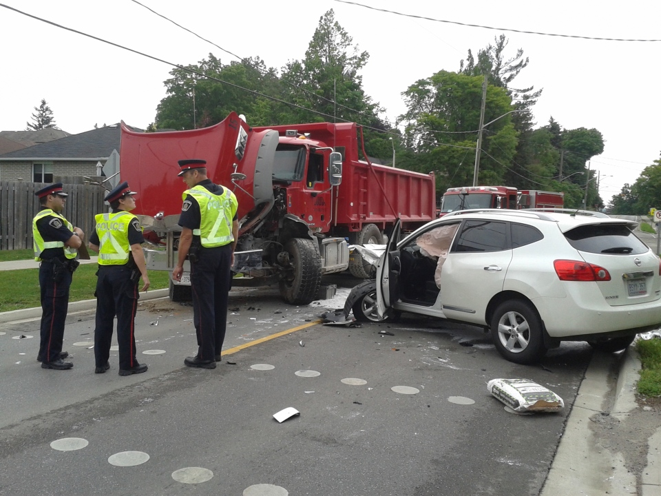 One person was injured in a crash between an SUV and a dump truck on Thomas Street on Tuesday, June 30, 2015. (Terry Kelly / CTV Kitchener)