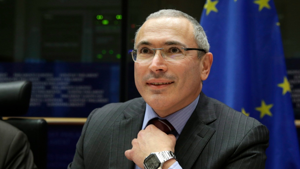 Russian businessman and Amnesty International prisoner of conscience Mikhail Khodorkovsky smiles as he attends the Foreign Affairs Committee for a debate on human rights situation in Russia at the European Parliament building, in Brussels on Tuesday, Dec. 2, 2014. (AP Photo/Yves Logghe)