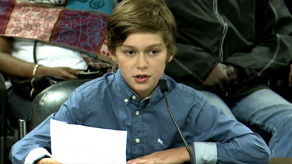 Boy speaking at city hall