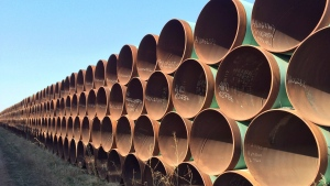 Pipes ready for the Keystone XL pipeline are shown shown in Gascoyne, N.D., on Wednesday April 22, 2015. (THE CANADIAN PRESS/Alex Panetta)