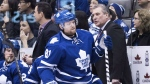 Toronto Maple Leafs' Phil Kessel, centre, moves down the bench in front of interim head coach Peter Horachek during first period NHL hockey action against the Columbus Blue Jackets in Toronto on Jan. 9, 2015. (Darren Calabrese / THE CANADIAN PRESS)