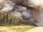 Smoke billows from a forest fire along highway 969 in southern Saskatchewan on June 29, 2015.  (Saskatchewan Ministry of Highways and Infrastructure / The Canadian Press)