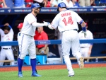 Toronto Blue Jays Justin Smoak is congratulated by teammate Kevin Pillar after hitting a two-run home run off Boston Red Sox Rick Porcello during first inning American League action in Toronto on July 1, 2015. (Frank Gunn / The Canadian Press)