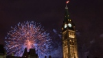 Fireworks explode behind the Peace Tower on Parliament Hill during Canada Day celebrations on Wednesday, July 1, 2015 in Ottawa. (Justin Tang / THE CANADIAN PRESS)