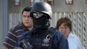 A federal police officer guards a polling station in Ciudad Victoria, in Tamaulipas state, Mexico, Sunday July 4, 2010. (AP / Eduardo Verdugo)