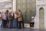 A bank employee talks to pensioners as they wait to be allowed into a bank to withdraw a maximum of 120 euros ($134) for the week, Thursday, July 2, 2015. (AP / Daniel Ochoa de Olza)