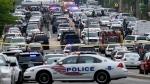 Police vehicles are seen near the Washington Navy Yard in Washington, Thursday, July 2, 2015. (AP / Susan Walsh)