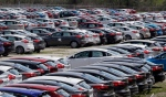 Ford Focus vehicles are seen on a storage lot on Friday, May 1, 2015 in Ypsilanti, Mich. (AP/Carlos Osorio)