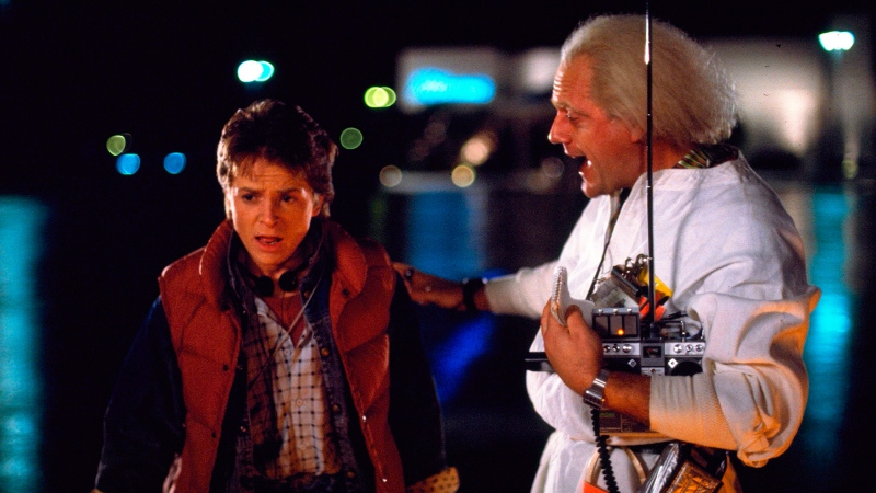 Michael J. Fox, left, as Marty McFly, and Christopher Lloyd as Dr. Emmett Brown, in a scene from the 1985 film, 'Back to the Future.' (Universal Pictures via AP)