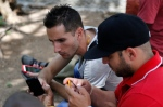 Internet users go online with their smartphones using the first public Wi-Fi hotspot in Havana, Cuba, Thursday, July 2, 2015. (AP/Desmond Boylan)