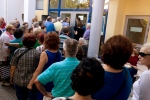 Pensioners line up as they wait to be allowed into a bank to withdraw a maximum of 120 euros ($134) for the week, Thursday, July 2, 2015.  (AP / Petros Giannakouris)
