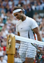 Rafael Nadal of Spain walks after losing the singles match against Dustin Brown of Germany, at the All England Lawn Tennis Championships in Wimbledon, London, Thursday July 2, 2015. (AP/Pavel Golovkin)