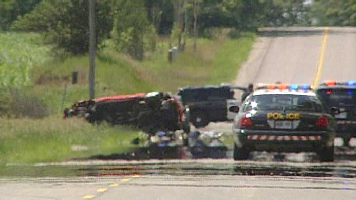 A van is seen on its side after a fatal collision involving a pedestrian on Napperton Drive west of Strathroy, Ont. on Thursday, July 2, 2015. (Gerry Dewan / CTV London)