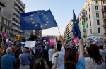 Demonstrators wave European Unions flag in support of the yes vote for the upcoming referendum in the northern Greek port city of Thessaloniki, Thursday, July 2, 2015. (AP / Giannis Papanikos)