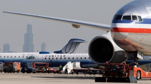 In this Oct. 5, 2010, file photo, an American Airlines jet, right, taxis past United Airlines and United Express jets at O'Hare International Airport in Chicago. (AP/M. Spencer Green)