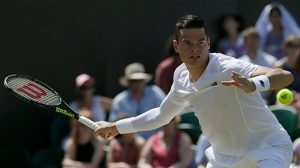 Milos Raonic of Canada returns a ball to Nick Kyrgios of Australia during their singles match at the All England Lawn Tennis Championships in Wimbledon, London, Friday July 3, 2015. (AP/Tim Ireland)