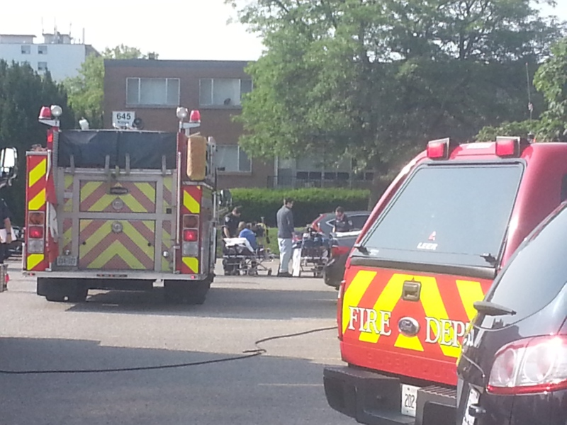 Paramedics attend to workers affected by pepper spray while working at 641 Kipps Ln. in London, Ont, on Friday, July 3, 2015. (Justin Zadorsky / CTV London)