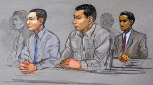 In this May 13, 2014 file courtroom sketch, defendants Azamat Tazhayakov, left, Dias Kadyrbayev, center, and Robel Phillipos, right, college friends of convicted Boston Marathon bomber Dzhokhar Tsarnaev, sit during a hearing in federal court in Boston. (Jane Flavell Collins via AP, File)