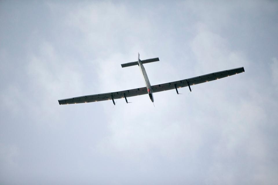 The Solar Impulse 2, a solar-powered airplane, circles the Kalaeloa Airport in Kapolei, HI. on Friday, July 3, 2015.  (AP / Marco Garcia)