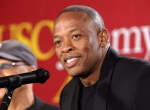 """This May 15, 2013 file photo shows hip-hop mogul Dr. Dre as he announces a donation to create the """"Jimmy Iovine and Andre Young Academy for Arts and Technology and Business Innovation,"""" at the University of Southern California, in Santa Monica, Calif. (AP/Damian Dovarganes, File)"""
