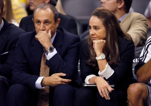 San Antonio Spurs assistant coaches Becky Hammon and Ettore Messina, of Italy, watch during the second half of the Spurs' NBA preseason basketball game against the Phoenix Suns on Oct. 16, 2014, in Phoenix. (Matt York / AP Photo)