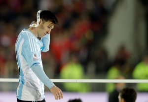 Argentina's Lionel Messi takes off the Copa America silver medal after the final game with Chile at the National Stadium in Santiago, Chile, Saturday, July 4, 2015. (Natacha Pisarenko / AP Photo)