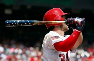 Washington Nationals' Bryce Harper (34) watches his two-run homer as he holds his Independence Day themed bat during the first inning of a baseball game against the San Francisco Giants at Nationals Park, Saturday, July 4, 2015, in Washington. (AP/Alex Brandon)