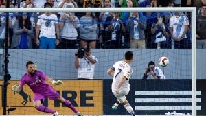 Los Angeles Galaxy forward Robbie Keane (7) scores on a penalty kick past Toronto FC goalkeeper Chris Konopka (1) during the first half of an MLS soccer game in Carson, Calif., Saturday, July 4, 2015. Keane scored three goals in their 4-0 win. (AP Photo/Alex Gallardo)