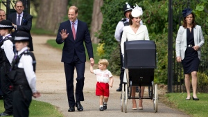 Britain's Prince William, Kate the Duchess of Cambridge, their son Prince George and daughter Princess Charlotte in a pram arrive for Charlotte's Christening at St. Mary Magdalene Church in Sandringham, England, Sunday, July 5, 2015. (AP / Matt Dunham)