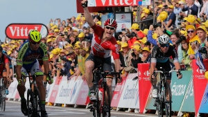 Germany's Andre Greipel crosses the finish line ahead of Peter Sagan of Slovakia, left, and Britain's sprinter Mark Cavendish, right, to win the second stage of the Tour de France cycling race over 166 kilometerswith start in Utrecht and finish in Neeltje Jans, Netherlands, Sunday, July 5, 2015. (AP/Christophe Ena)
