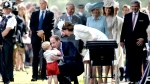 Britain's Prince William picks up his son Prince George as Kate, the Duchess of Cambridge watches, as they walk past crowds at the Church of St Mary Magdalene on the Sandringham Estate after the christening of their daughter Princess Charlotte, at the Church of St Mary Magdalene on the Sandringham Estate, England, Sunday, July 5, 2015. (AP / Mary Turner)